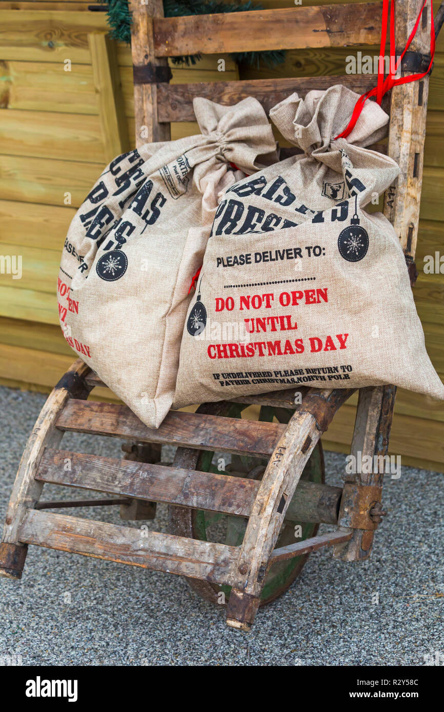 Sacks of Christmas presents at Gloucester Quays Victorian Christmas Market, Gloucester, Gloucestershire in November - do not open until Christmas day - Stock Image