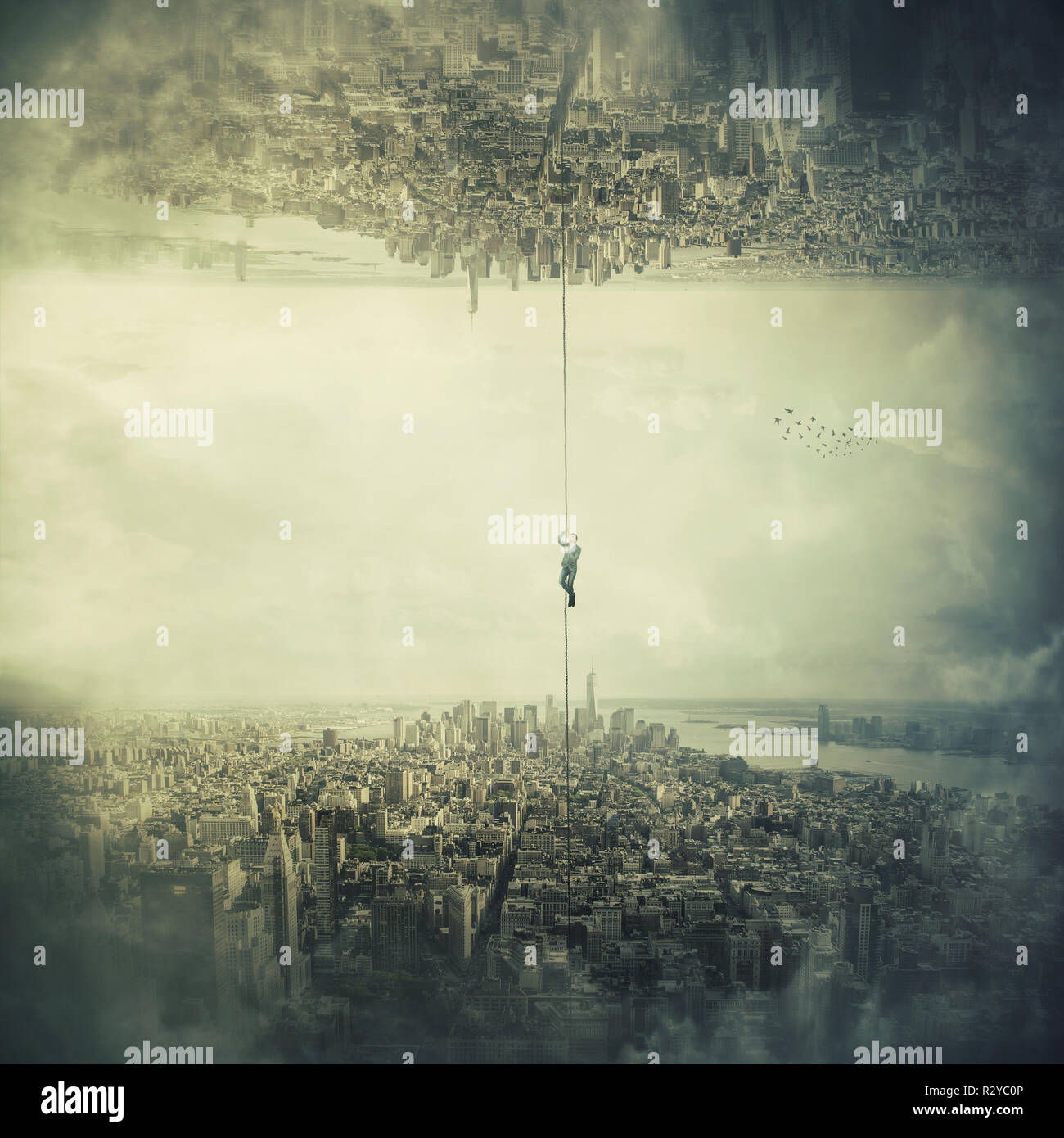 Man hanging on chain escape from the city to another parallel reality. Mystical concept salvation and life change, trying to climb up the rope. Risk a - Stock Image