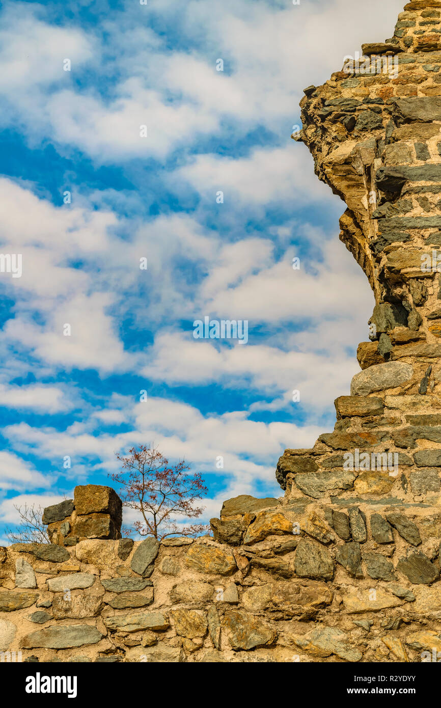 Exterior view of antique broken stone material building located at piamonte district, Italy - Stock Image