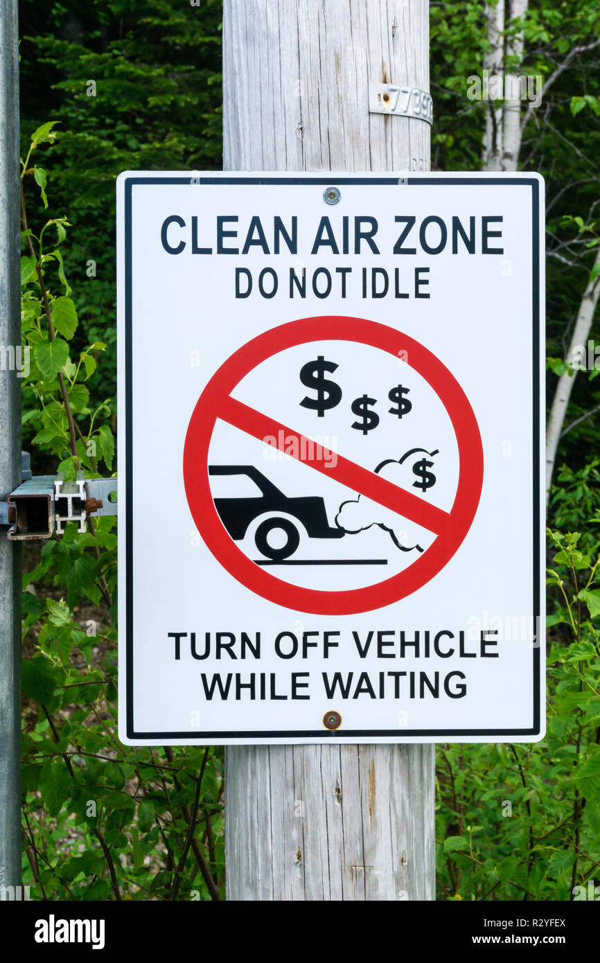 A Clean Air Zone sign in Canada tells drivers to switch their car engine off when stationary or stopped. - Stock Image