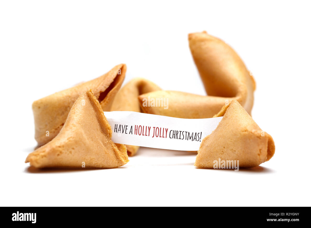 Have a holly jolly Christmas. Photo of chinese cookies with text wishes on blank white background - Stock Image