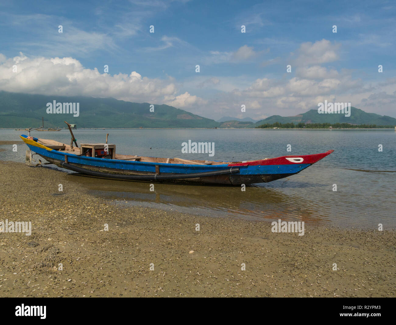 Fishing boat moored on beach of Lang Co village South Vietnam between Lap An Lagoon and South China Sea known for seafood - Stock Image