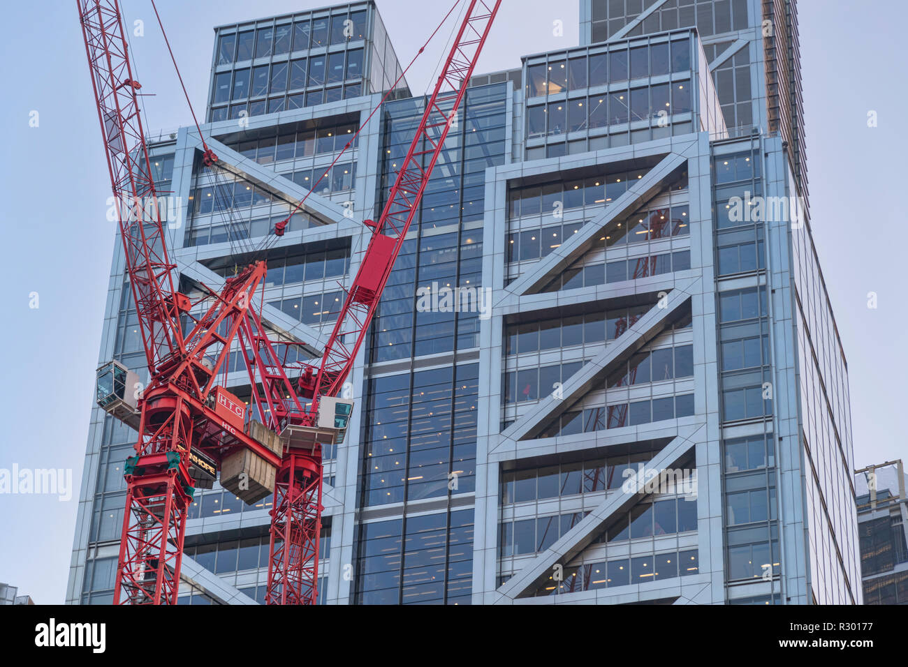 Two tower cranes next to The Heron Tower, Bishopsgate, City of London - Stock Image