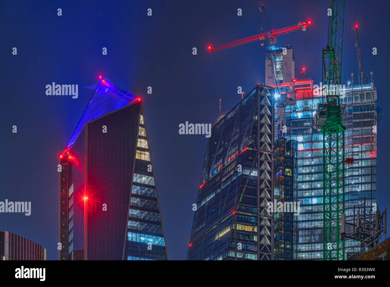 The Scalpel, Cheesegrater and 22 Bishopsgate at night in the City of London - Stock Image