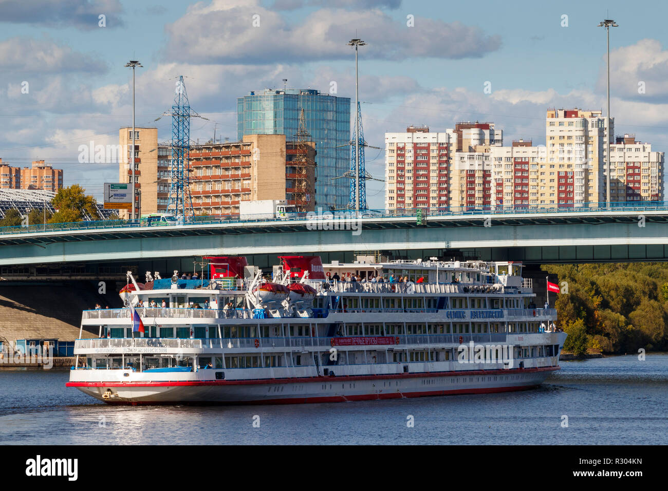 The 1978 Felix Dzerzhinsky cruise ship on the Moscow Canal in central Moscow as it passes under a road bridge heading to St Petersburg, Russia. - Stock Image