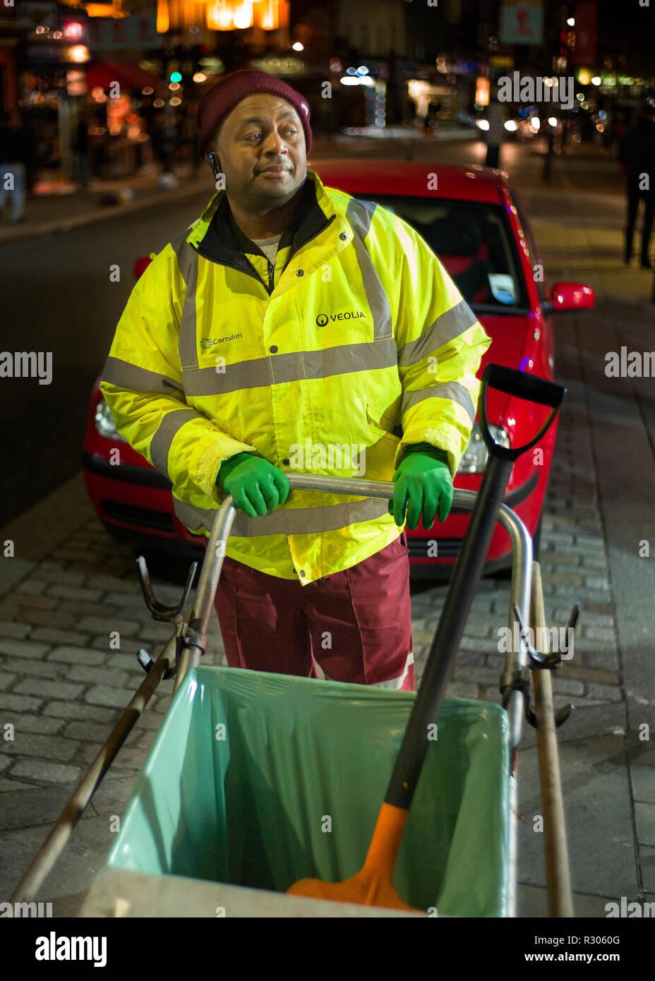 street cleaner at night, Camden High street London, Stock Photo