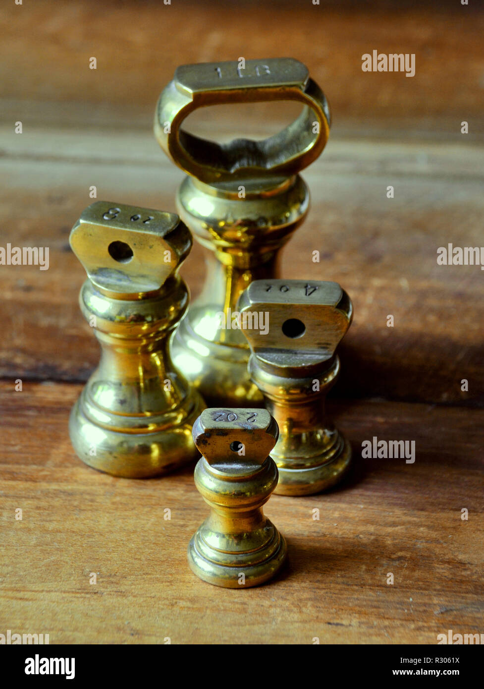 selection of imperial brass measuring weights - Stock Image