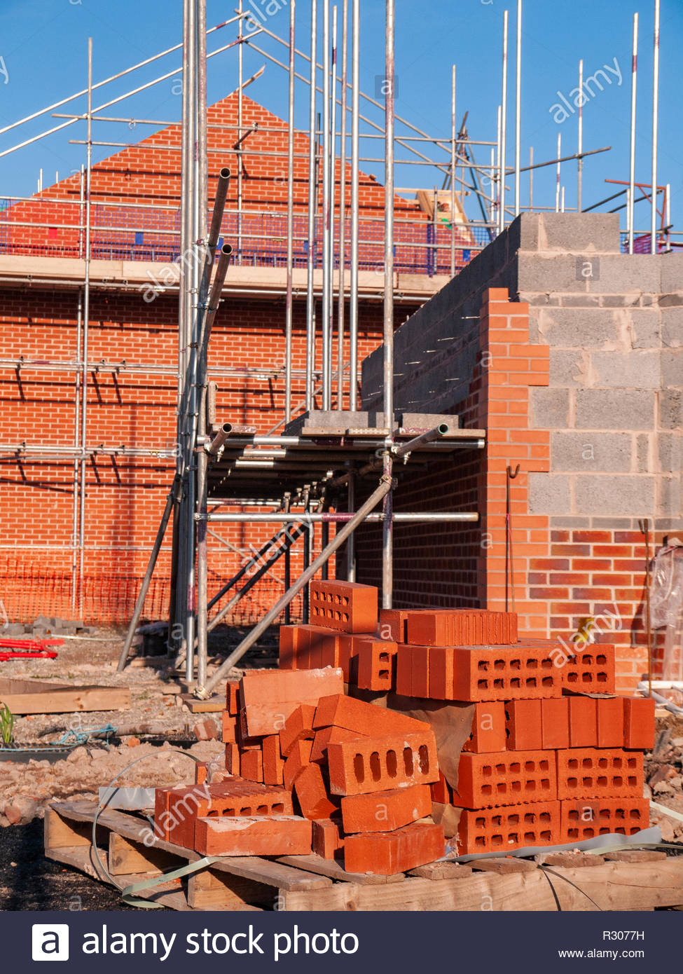 New houses under construction and in scaffolding in Cheshire England UK - Stock Image