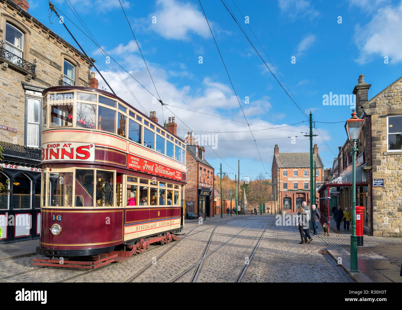 Old tram on the High Street in the 1900s Town, Beamish Open Air Museum, Beamish, County Durham, England, UK - Stock Image