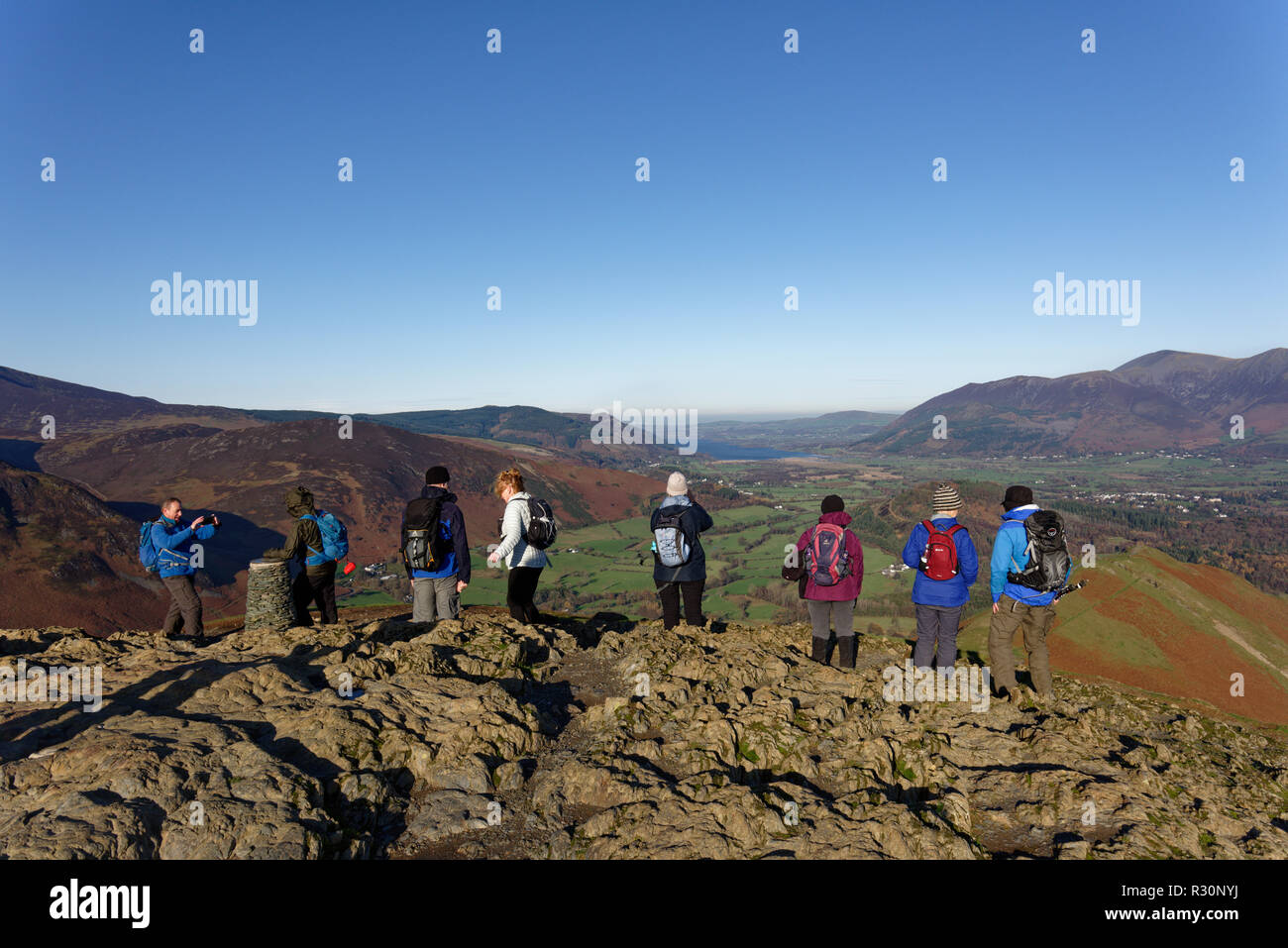 Fell walkers enjoying the wonderful view from the top of Catbells a small mountain near Keswick in the Lake District National Park - Stock Image