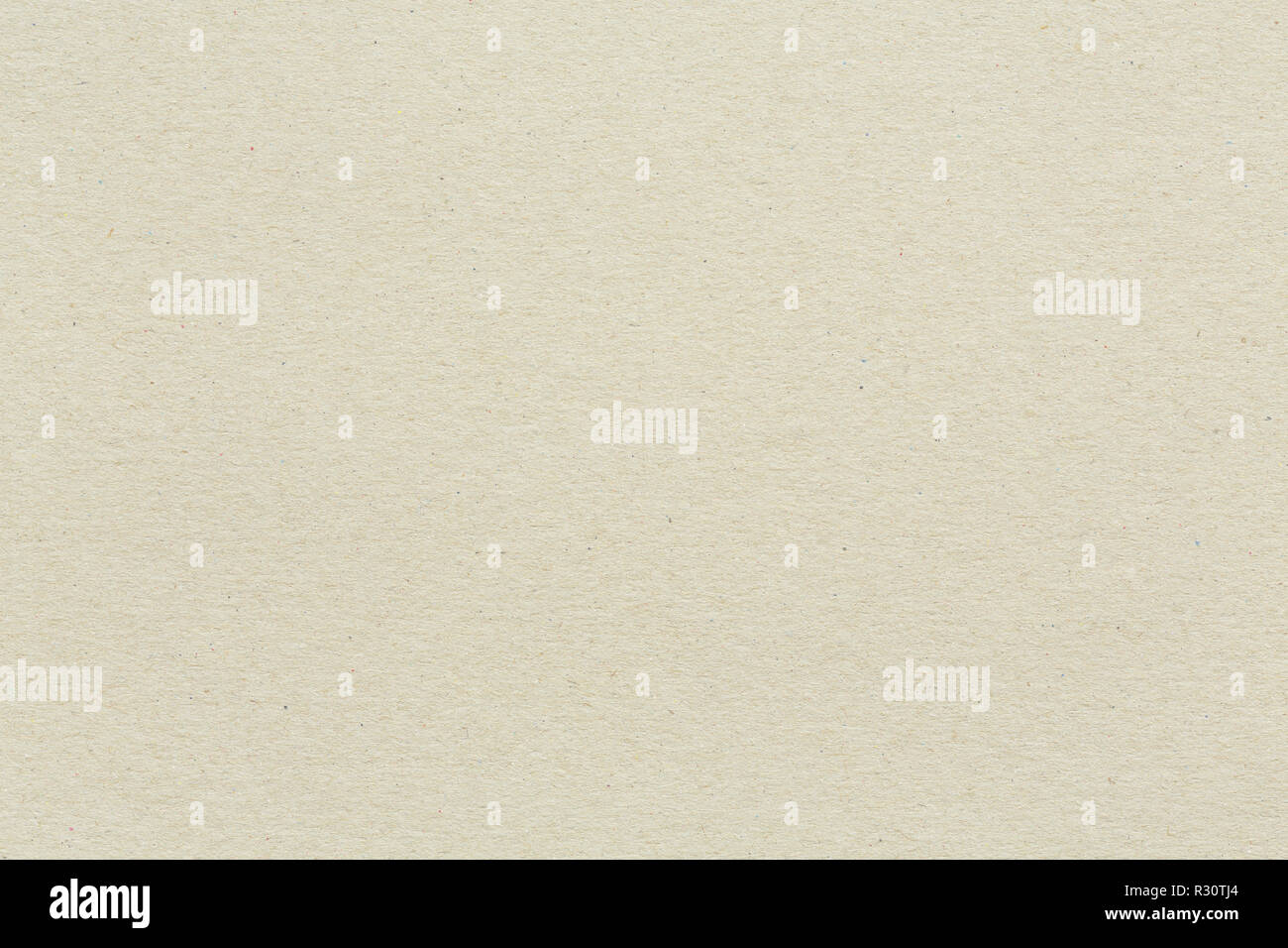 Recycled paper or cardboard background with coloured flecks and fibre texture - Stock Image