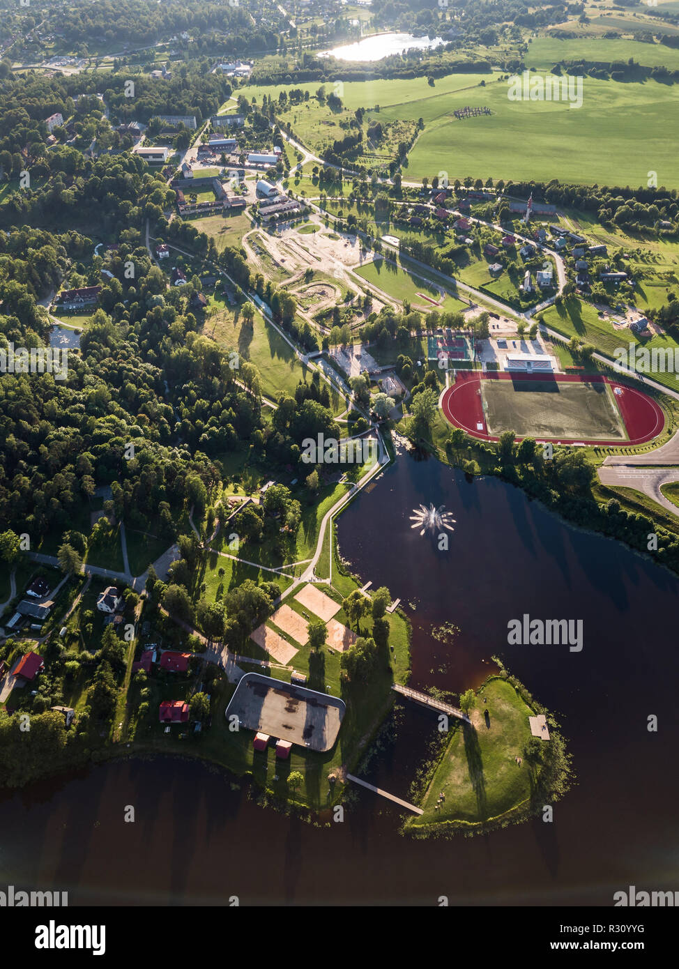 Aerial Drone Photography of the City with the Lake and Stadium Surrounded in Beautiful Spring Colors on a Sunny Day - Stock Image