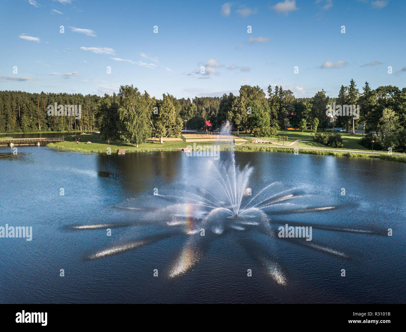 Aerial Drone Photography of the City with the Lake and Stadium Surrounded in Beautiful Spring Colors on a Sunny Day - Closeup on the Fountain - Stock Image