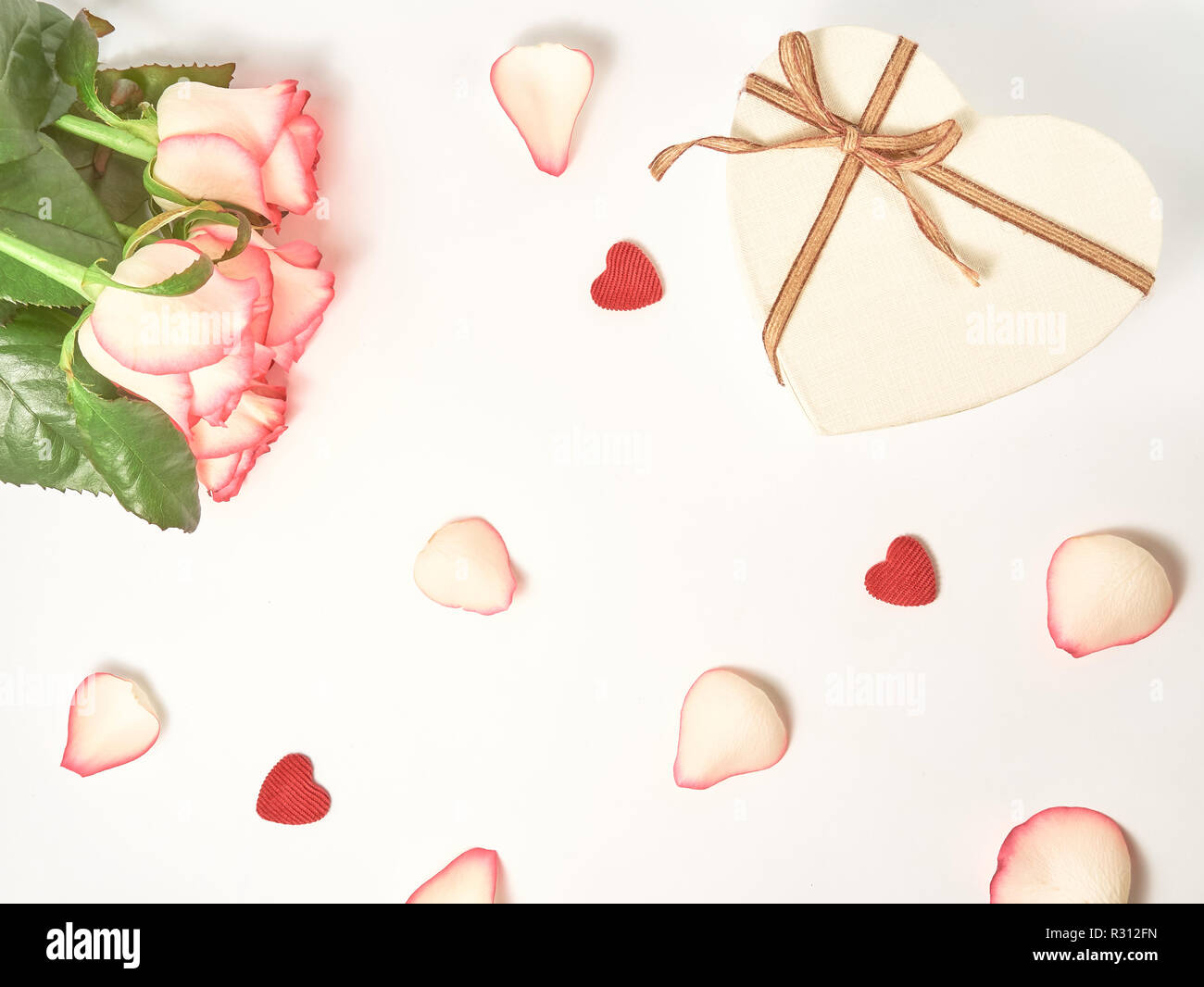 Gift and roses composition on the white background. Top view, flat lay. Birthday, Mother's, Valentines, Women's, Wedding Day concept. Stock Photo