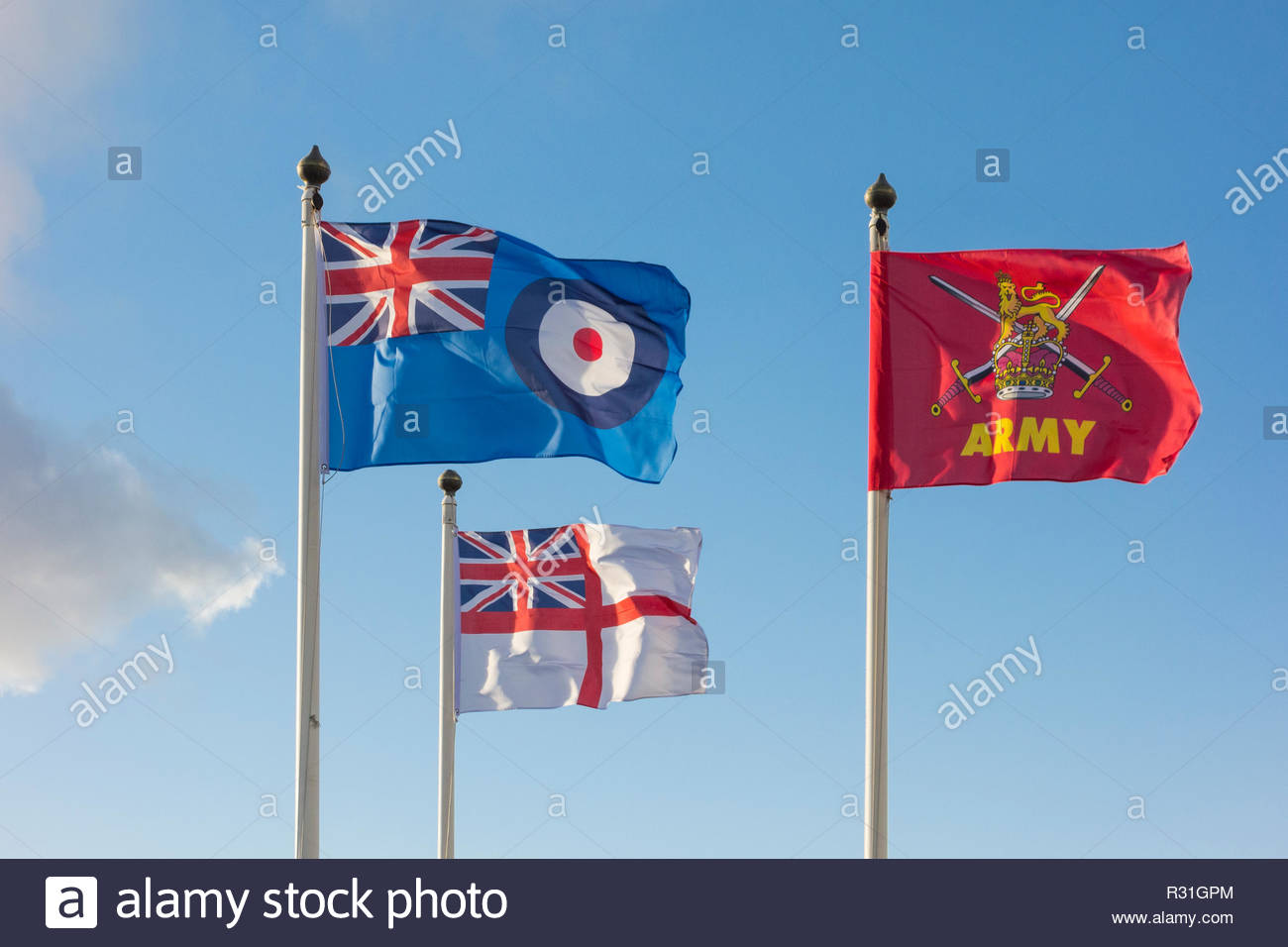 Flags for the Army, Royal Navy and Royal Air Force flying by the war memorial on Marine Road, Morecambe, Lancashire on 11 Nov 2018 - Stock Image