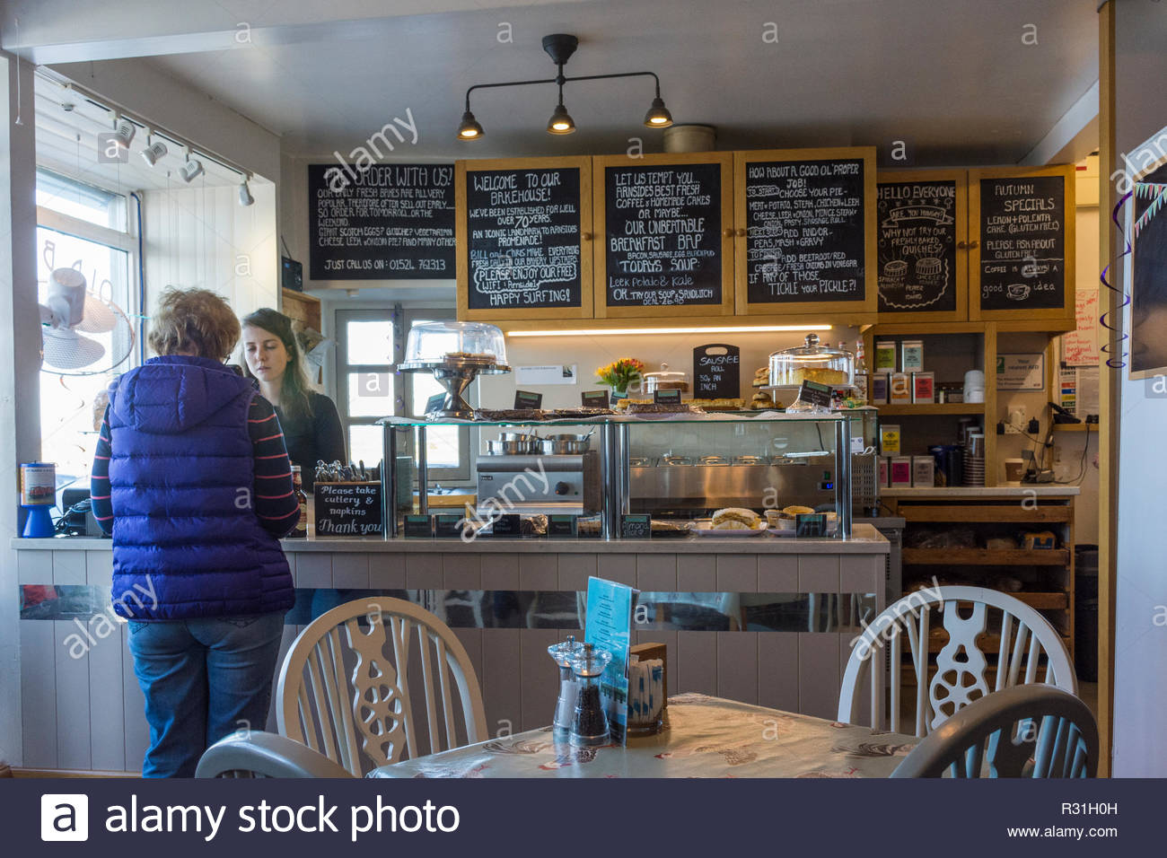 The serving counter in the Bakehouse cafe on the promenade in Arnside, Cumbria - Stock Image