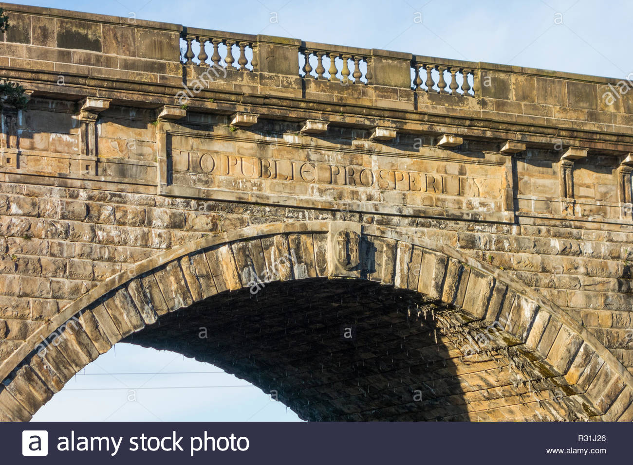Inscription on the arch of the Lune Aqueduct over the River Lune at Lancaster UK - To Public Prosperity - Stock Image