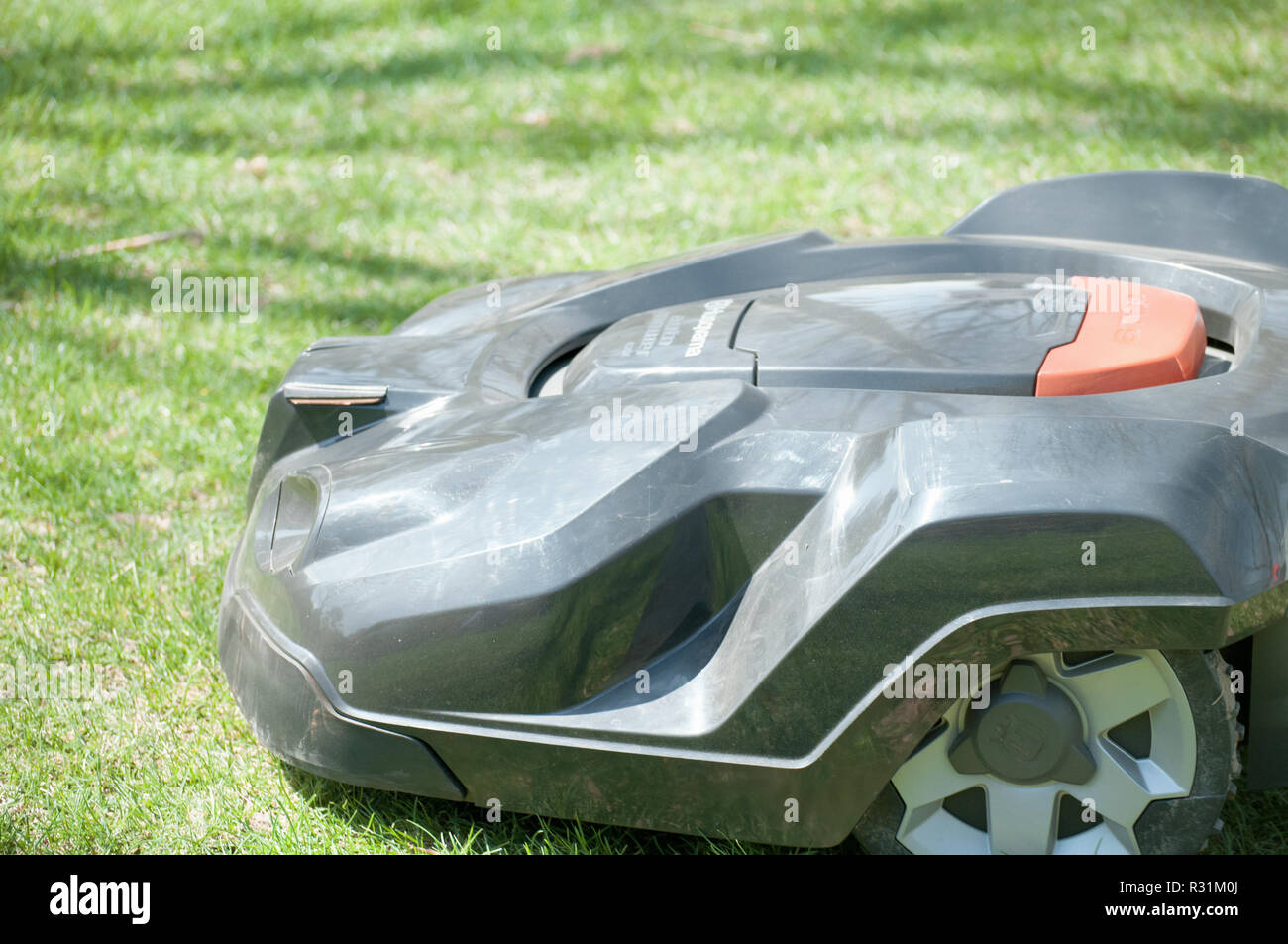 A husqvarna Automatic lawn mowing machine. - Stock Image
