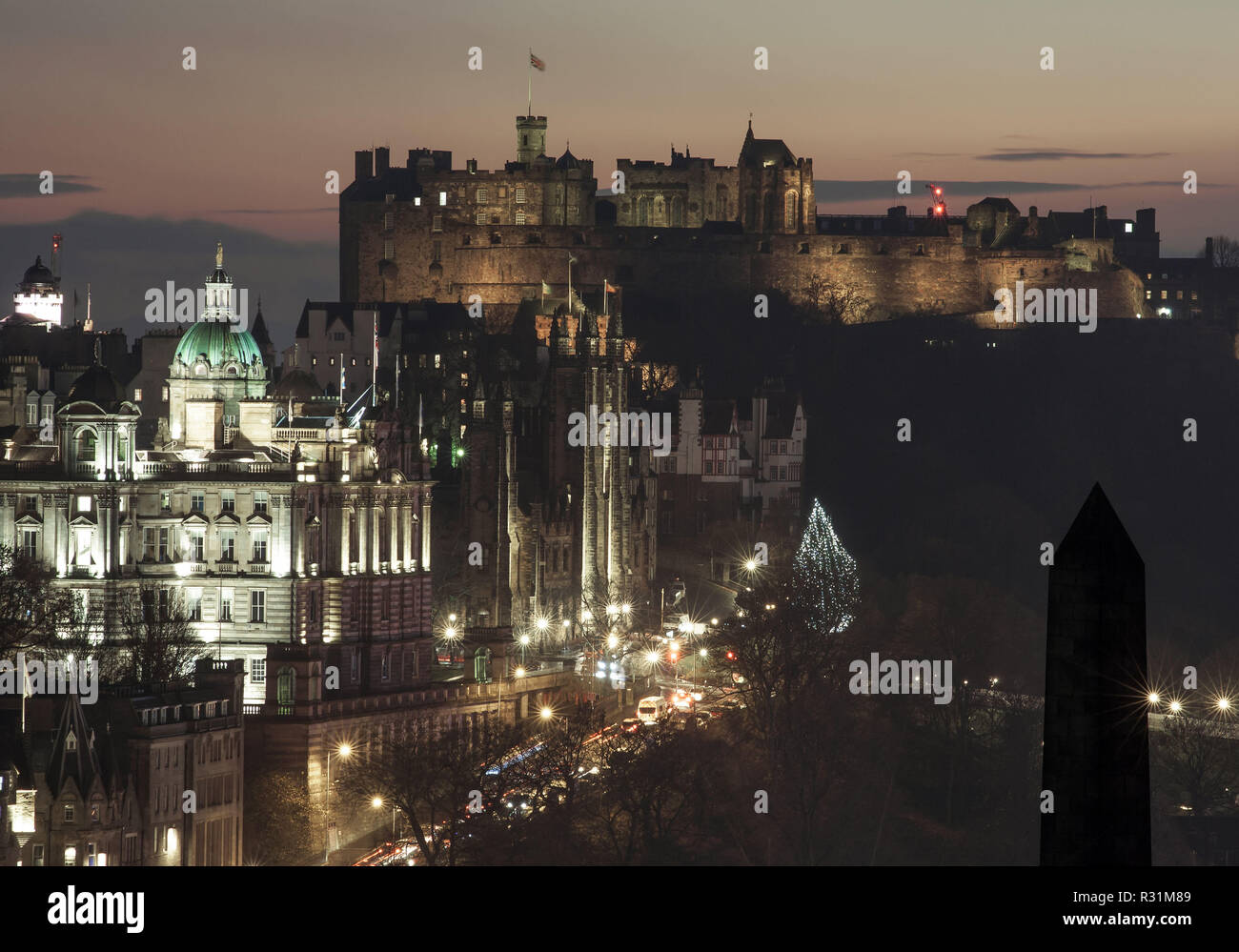 Edinburgh, Scotland. 11/18/18. View of Edinburgh's Castle at dusk from Calton Hill, with lights on and Christmas tree in the street Stock Photo