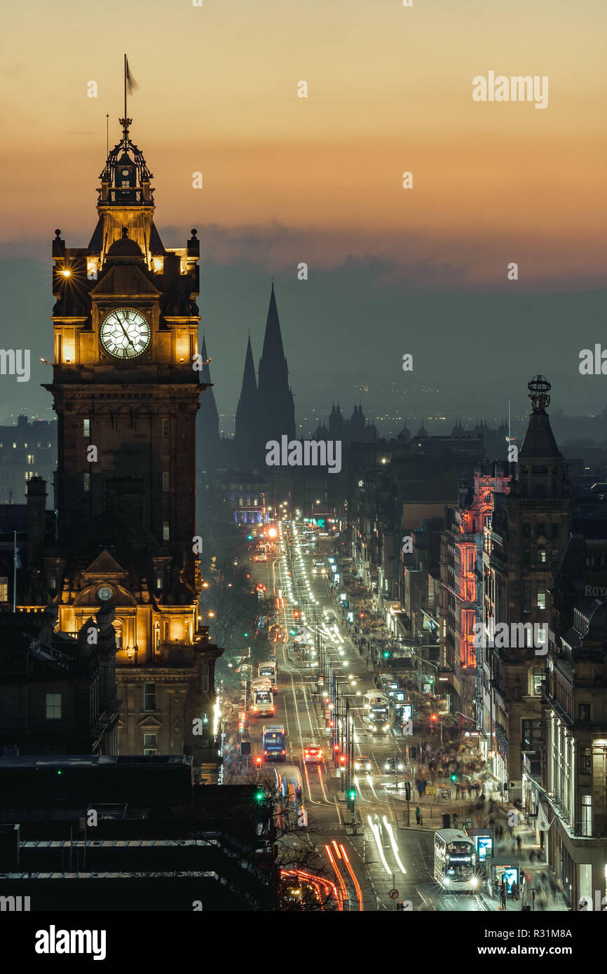 Edinburgh, Scotland. 11/18/18. View of Princess Street from Calton Hill at dusk, with lights on and beautiful color in the sky. Long exposure Stock Photo