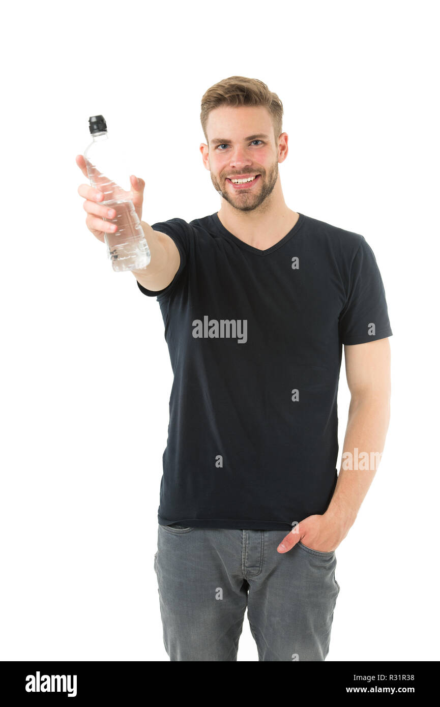 Man athlete hold water bottle. Guy drink water on white background. Man care health and water balance. Sportsman care hydration water nourishment body. Healthy lifestyle concept. Feeling thirsty. - Stock Image