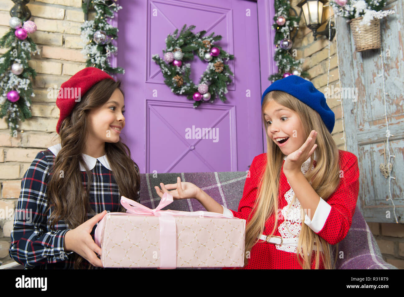 Small cute girls received holiday gifts. Best toys and christmas ...
