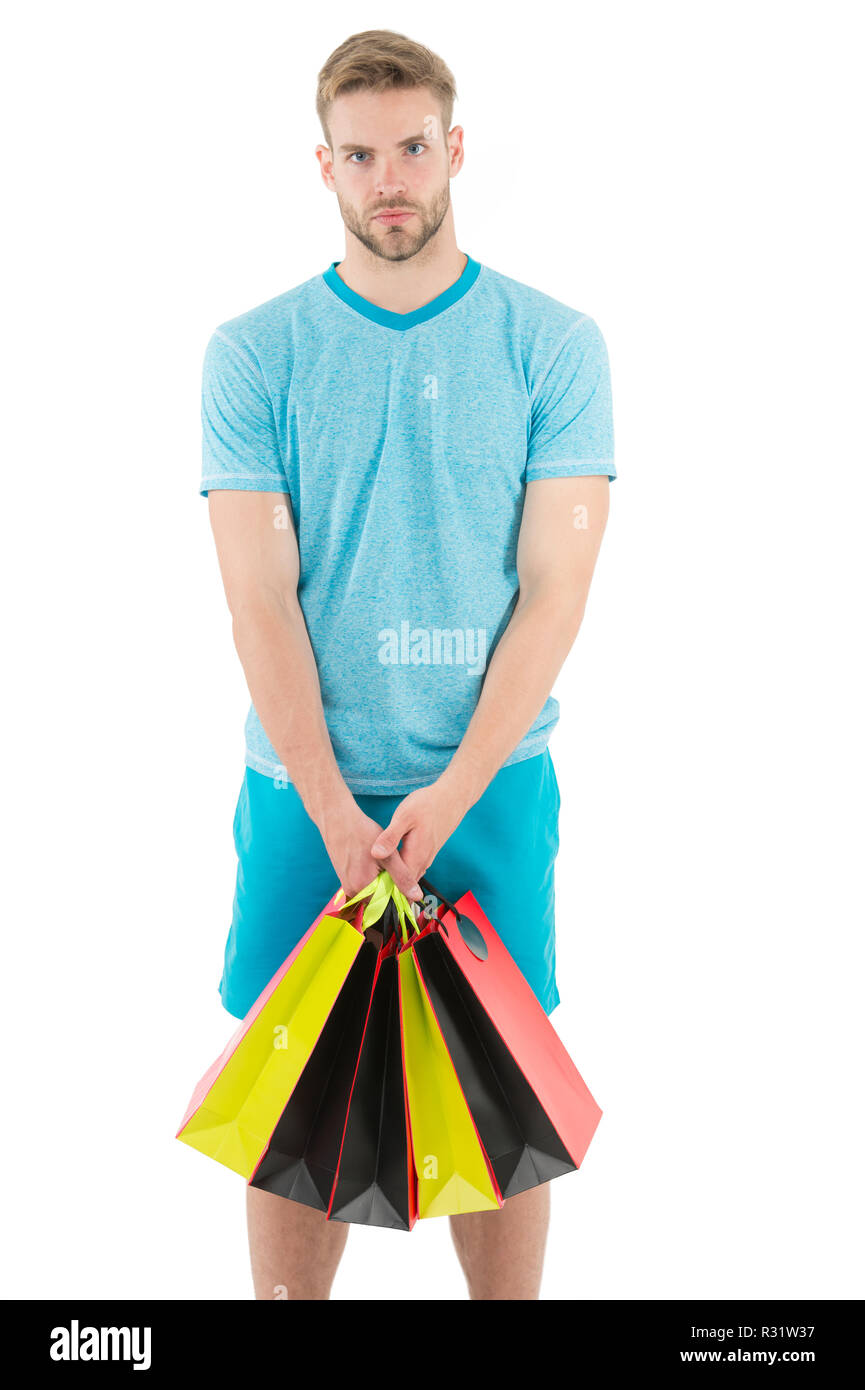 Man handsome unshaved macho hold bunch shopping bags. Buy gifts concept. Guy shopping before holidays. Shopping discount sale season. Man carry paper bags with items. Shopping confusing him. - Stock Image