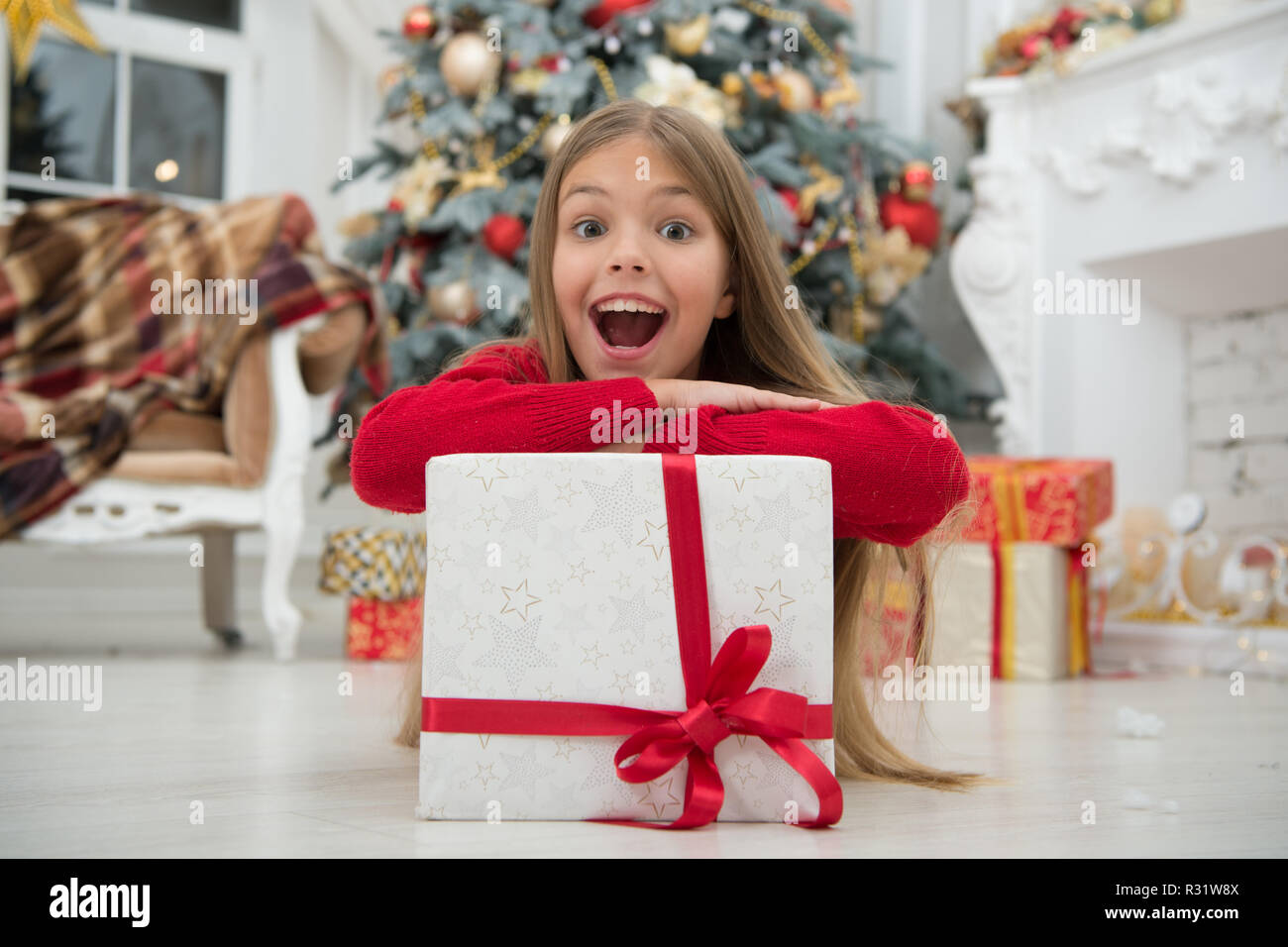 Christmas is coming. Small cute girl received holiday gift. Best christmas gifts. Kid little girl in elegant dress and gift box christmas tree background.  sc 1 st  Alamy & Christmas is coming. Small cute girl received holiday gift. Best ...