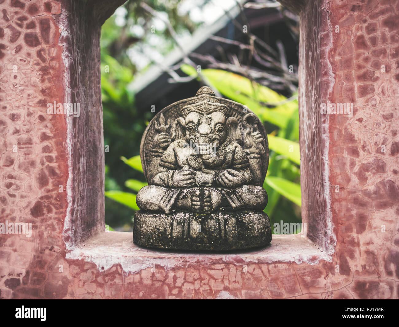 Lord Ganesha Statue At Wall Stock Photos & Lord Ganesha