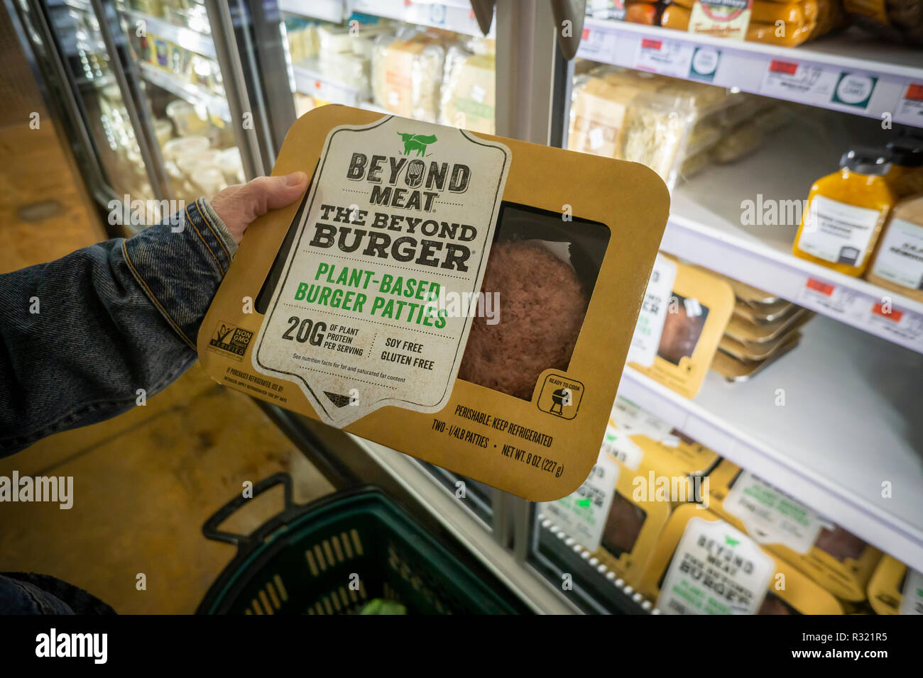 A shopper chooses a package of Beyond Meat from a freezer in a supermarket in New York on Monday, November 19, 2018. The plant-based protein start-up Beyond Meat has filed for an initial public offering for $100 million. The global market for meat substitutes is expected to grow to $6.4 billion by the year 2023, currently it is estimated at $4.6 billion. (© Richard B. Levine) - Stock Image