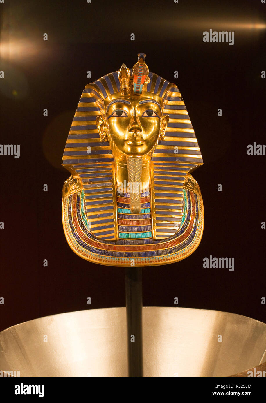 Made of solid gold lapiz, and precious gems, the death mask of King Tutankhamun, or King tut, on display at an American museum. - Stock Image