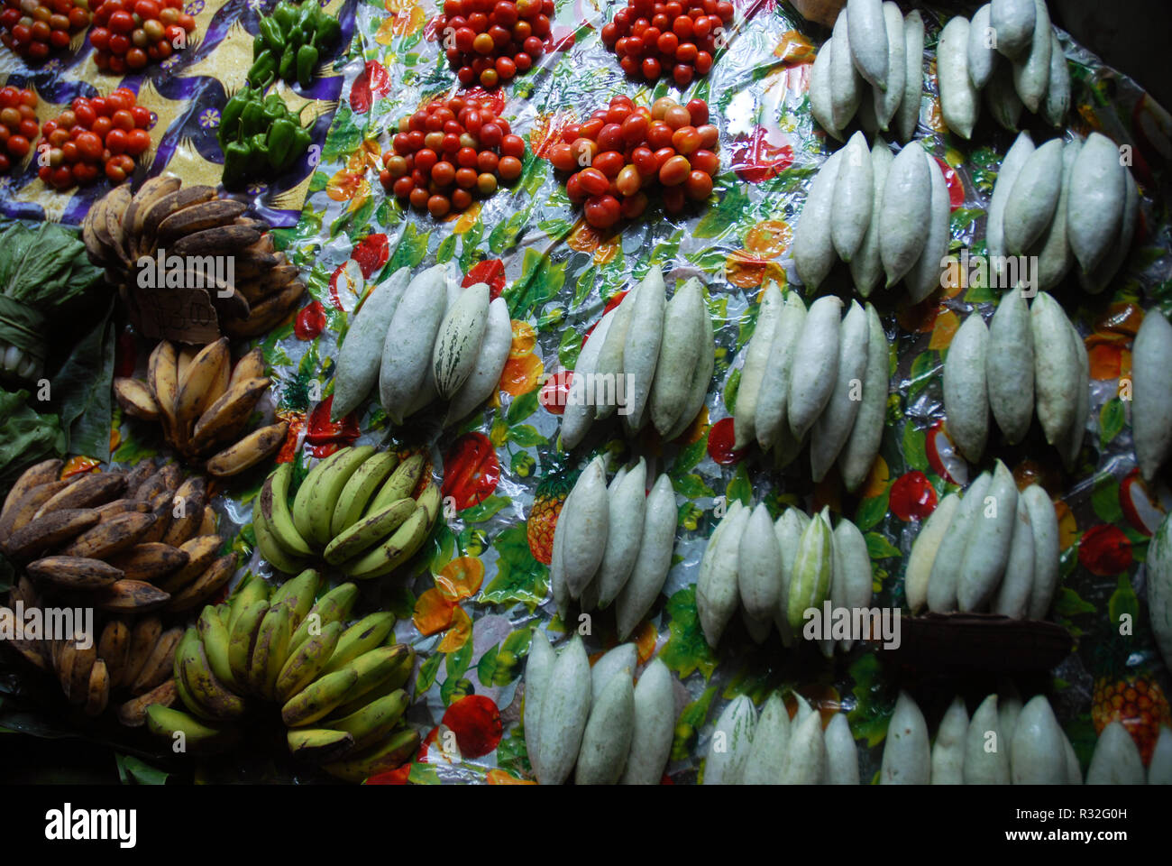 Small piles of fruit and vegetables to sell at Honiara Central Market, Honiara, Solomon Islands. - Stock Image
