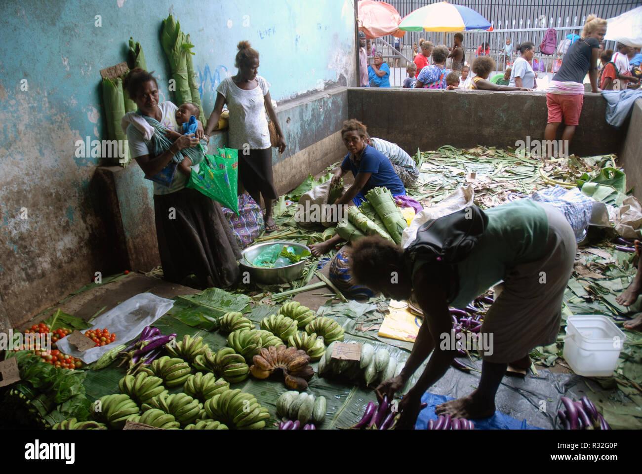 Selling fruit and vegetables at Honiara Central Market, Honiara, Solomon Islands. - Stock Image
