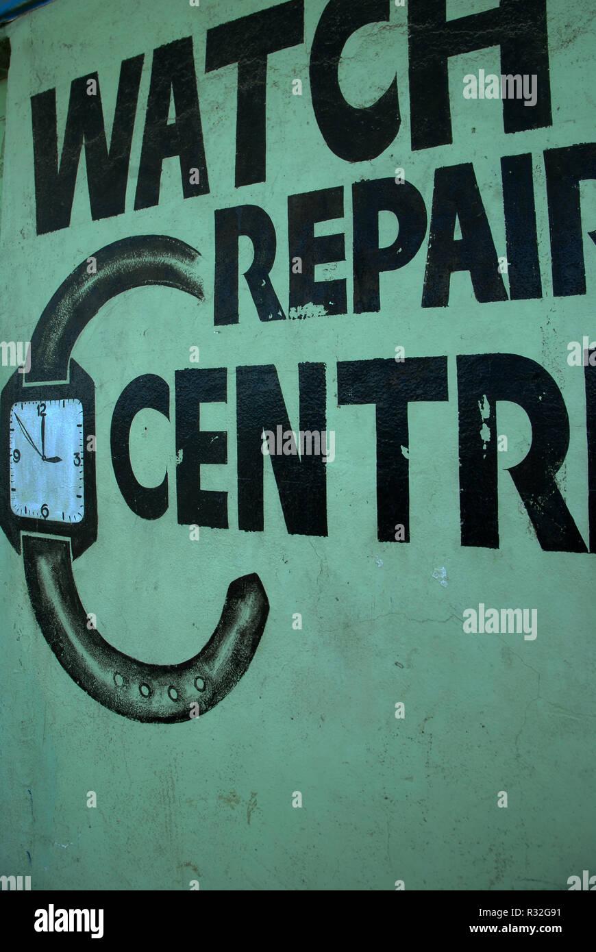 Watch Repair Centre Sign, Honiara, Solomon Islands. - Stock Image