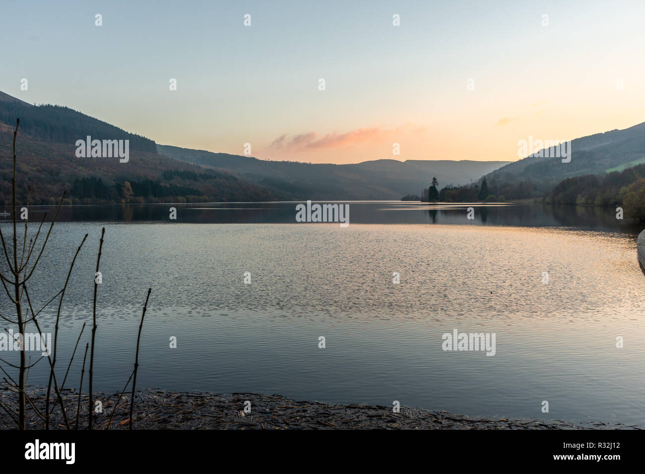 Scenic view across the Talybont Reservoir in the Brecon Beacons during sunset, Powys, Wales, UK - Stock Image