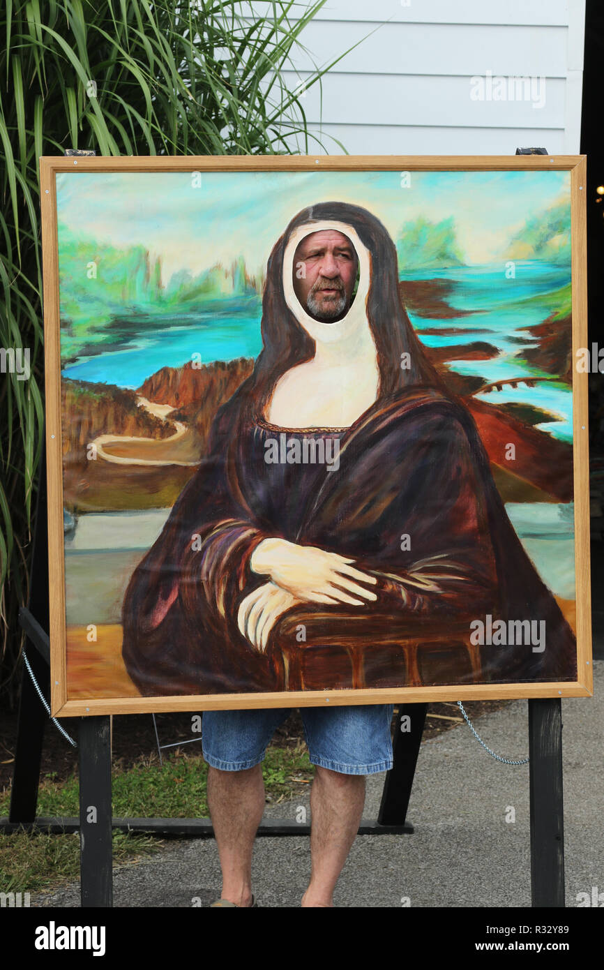 Fun painting of the Mona Lisa, originally by Leonardo da Vinci, with a face cutout for people to show their faces. Canfield Fair. Mahoning County Fair - Stock Image