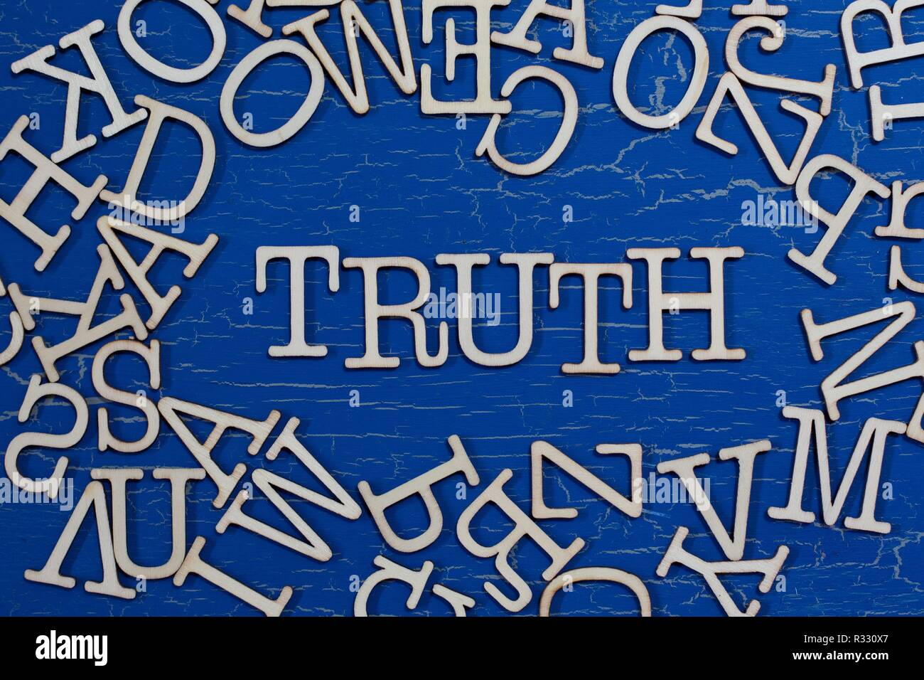 The word 'TRUTH' spelled out among a jumble of letters. - Stock Image