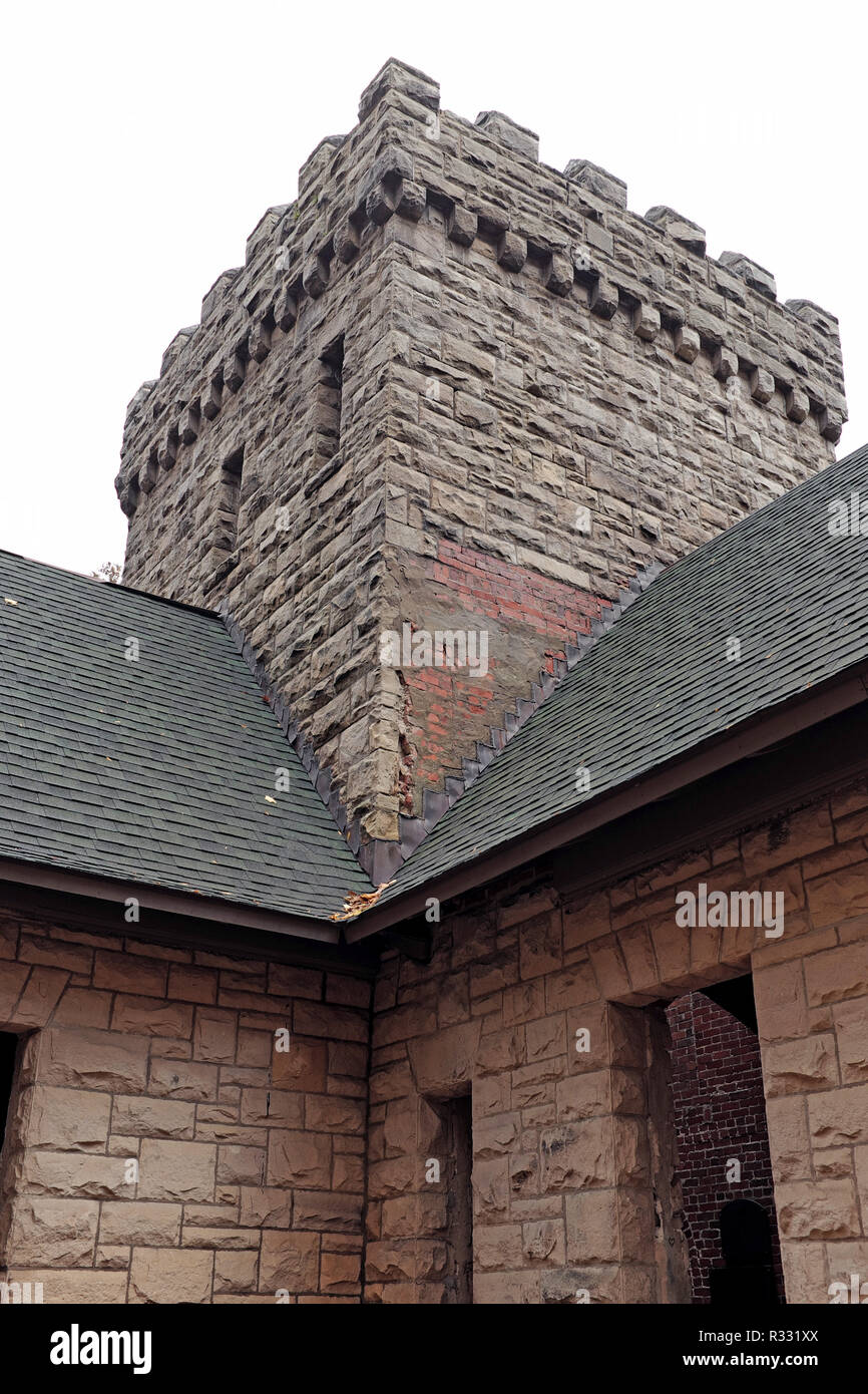 The Romanesque Revival style Squires Castle spire made of Euclid bluestone, a bluish-colored sandstone, in the North Chagrin Reservation in Cleveland. - Stock Image