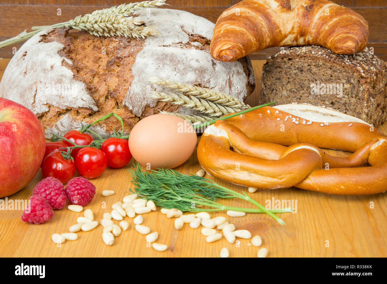 different kinds of bread and a variety of foods - Stock Image