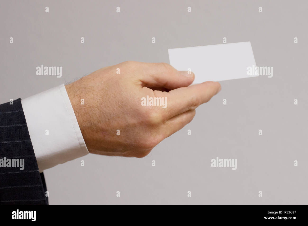 handover of the business card - Stock Image