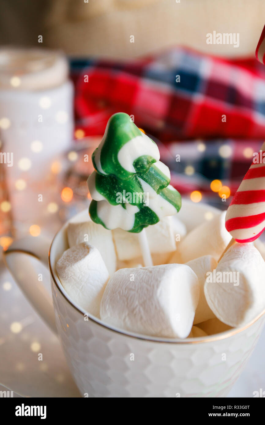 Mug Of Hot Chocolate And Cacao With Marshmallows With Candy Garland