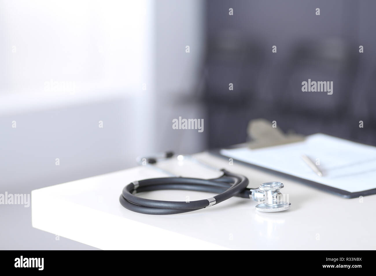Stethoscope and medical history form lying at reception desk