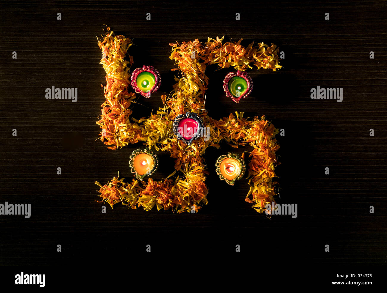 5 colourful diyas placed on table to celebrate diwali and dhanteras festival in India Stock Photo
