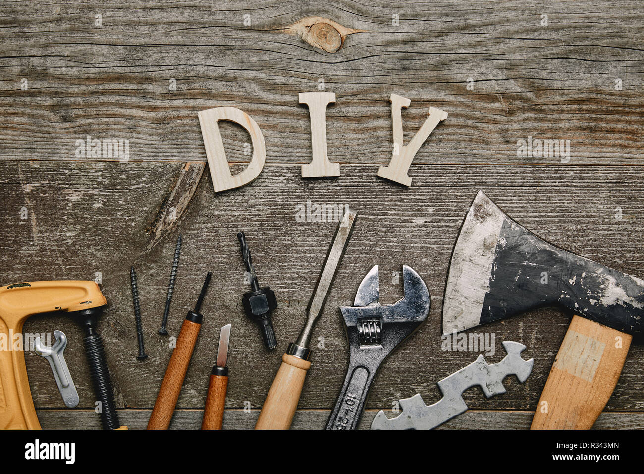 Flay Lay With Different Carpentry Tools And Diy Sign On Wooden