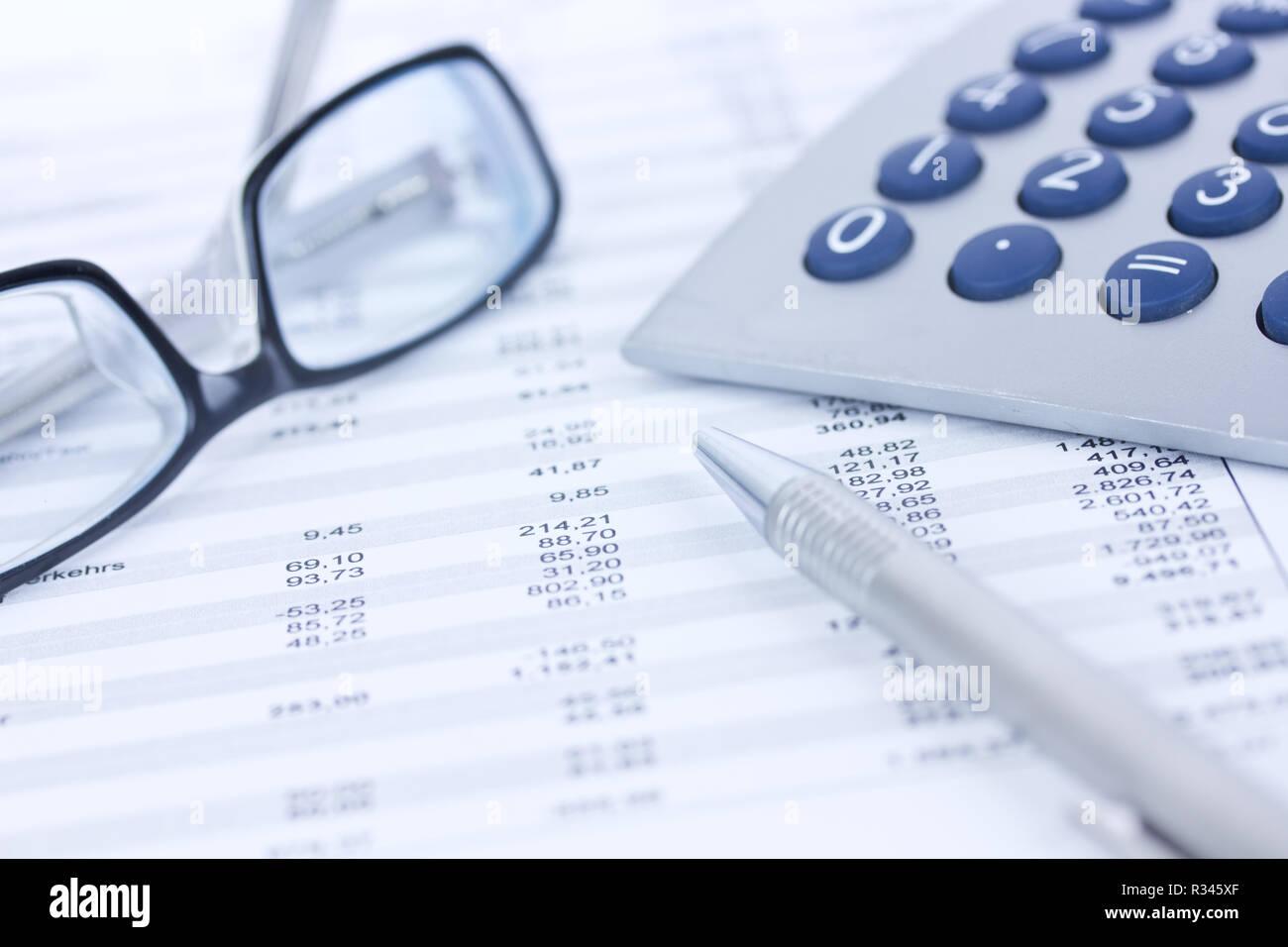 calculators and columns of figures Stock Photo