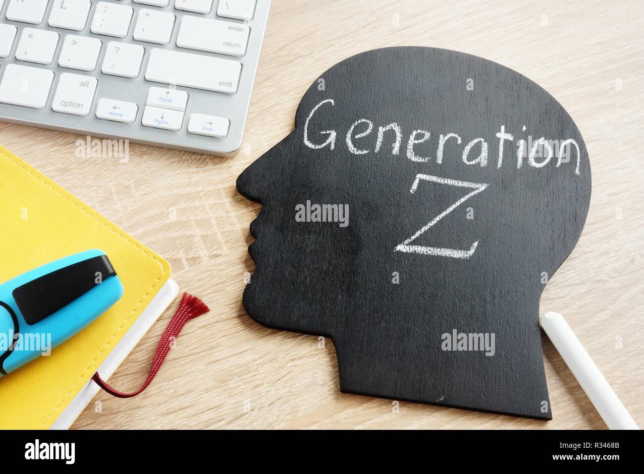 Generation Z written on a blackboard in the shape of a head. - Stock Image