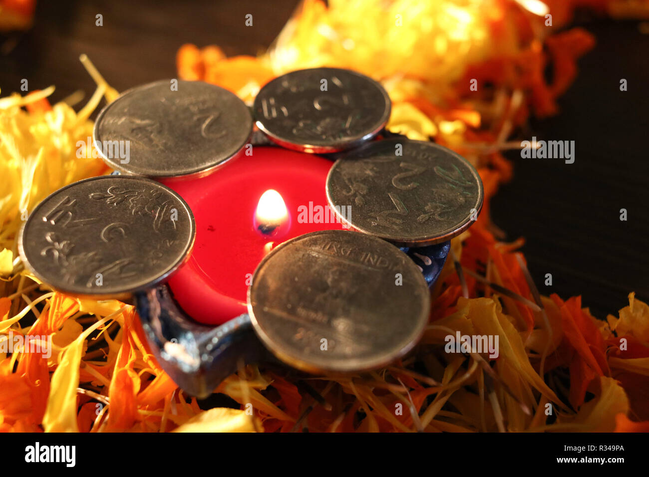 A close- up view of single lit diya for celebrating diwali and dhanteras festival in India Stock Photo