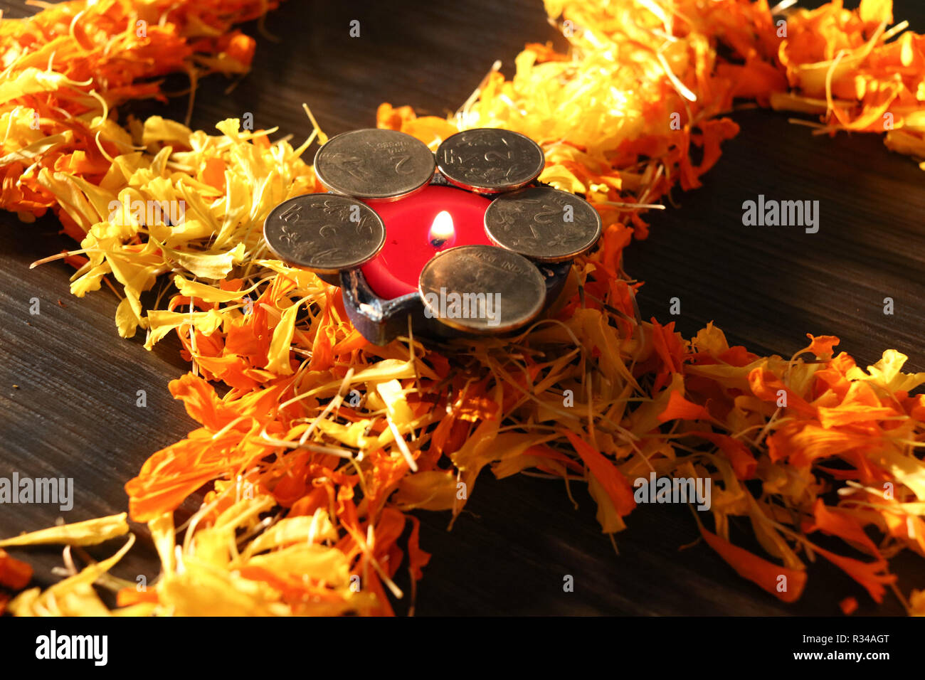 Isolated diya placed on swastik for celebrating diwali and dhanteras festival in India Stock Photo