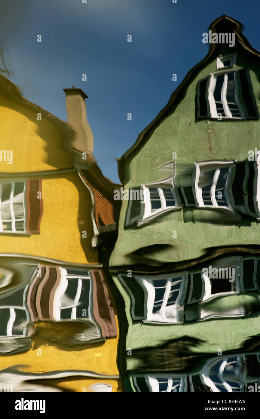 houses mirrored in the river - Stock Image