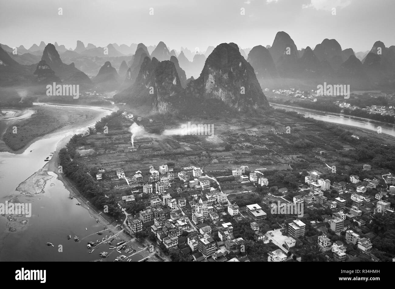 Black and white picture of the Lijiang River at sunset, Guangxi, China. - Stock Image